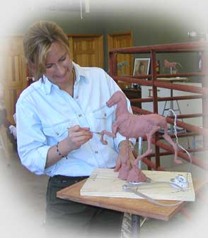 "Sondra sculpting ""Rack On"" in a workshop in Taos"